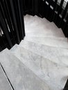 Winder steps which are curved in plan with marble step Royalty Free Stock Photo