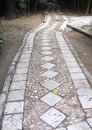 Winding cobblestone road Stock Photo
