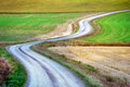 Winding country road in rural area in early fall Stock Image
