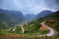 Winding mountain road in ha giang province vietnam Stock Images