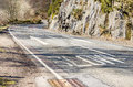 Winding Mountain Road and Warning Signs on Tarmac Royalty Free Stock Photo