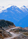 Winding path into mountains Royalty Free Stock Photo