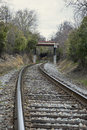 Winding railroad track curved leading into overpass Stock Image