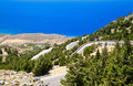 Winding road on a crete in mountains of greece Stock Photos