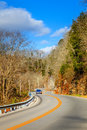 Winding road in kentucky two lane curving through the woods the hills of Stock Images