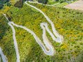 Winding road on mountain, Queenstown, New Zealand Royalty Free Stock Photo