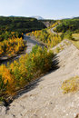 Winding road and river in valley Stock Image