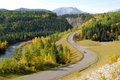Winding road in river valley Royalty Free Stock Photography