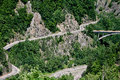 Winding road in romania and bridge Royalty Free Stock Photography