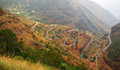Winding road this is to lugu lake from lijiang here is called linin eighteen bends Royalty Free Stock Images