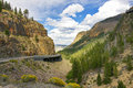 Winding scenics road thru the mountains in the yellowstone national park usa Stock Image