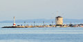 Windmill on sea wall, Corfu, Greece Royalty Free Stock Photo
