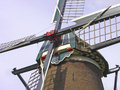 Windmill cross with sails close up of traditional dutch wind mill four sail arms in closeup Royalty Free Stock Photography