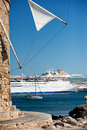 Windmill with cruise ship in the background Royalty Free Stock Image
