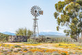 Windmill, dam and a kraal Royalty Free Stock Photo