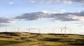 Windmill farm in beautiful landscape Royalty Free Stock Photo