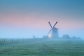 Windmill in fog at sunrise Royalty Free Stock Photo