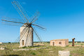 Windmill in formentera simon made out of whitewashed rubblework the top floor for machinery and the grindstone the first Stock Image