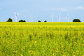 Windmill on a green field wind turbine Royalty Free Stock Photos