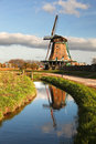 Windmill in holland with canal traditional dutch windmills amsterdam area Stock Images