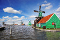 Windmill in holland with canal traditional dutch windmills amsterdam area Royalty Free Stock Image