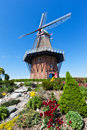 Windmill in holland michigan at springtime an authentic wooden from the netherlands stands among tulips and other vegetation on Royalty Free Stock Image