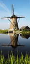 Windmill in kinderdijk scenic view of of reflecting canal foreground netherlands Stock Image