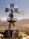 Windmill in lanzarote canary islands at caleta de farmara beach Stock Image