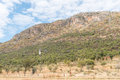 Windmill with mountain backdrop between Otavi and Kombat Royalty Free Stock Photo
