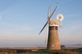 Windmill on norfolk broads restored by river thurne Stock Images