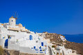 Windmill in oia at santorini island greece vacation background Stock Photography