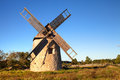 Windmill an old on gotland in beautiful warm evening sunlight with blue sky Stock Photography