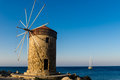 Windmill from the old harbor of rhodes Stock Images