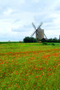 Windmill and poppy field Stock Photos