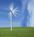 Windmill power generator on green grass and blue sky Royalty Free Stock Images