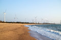 Windmill and power station on the coast Stock Photos