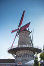 Windmill with red wings in Sluis, Holland Royalty Free Stock Photo