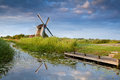 Windmill reflected in river Royalty Free Stock Photo