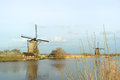 Windmill with reflection in the water landscape winter at kinderdijk netherlands Stock Photography