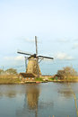 Windmill with reflection in the water landscape winter at kinderdijk netherlands beautiful Stock Photography
