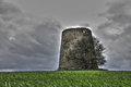 Windmill in ruins in front of a dramatic sky Royalty Free Stock Photo