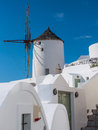 Windmill in santorini winmill of oia greece Stock Photo