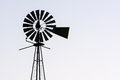 Windmill silhouette on a light grey background Royalty Free Stock Images