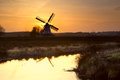 Windmill silhouette at sunrise Royalty Free Stock Photo