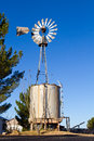 Windmill and water tank old fashioned watertank to provide to homestead in rural western texas Royalty Free Stock Photography