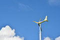 Windmill or weather vane against blue sky Royalty Free Stock Photos