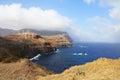 Windmills on abrupt coast of ocean Royalty Free Stock Photos