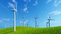 Windmills on green hills against blue sky Royalty Free Stock Photo