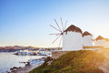 Windmills of mykonos famous in island with view city greece Stock Photos