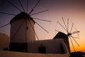 Windmills in mykonos the sunset greece Royalty Free Stock Photography